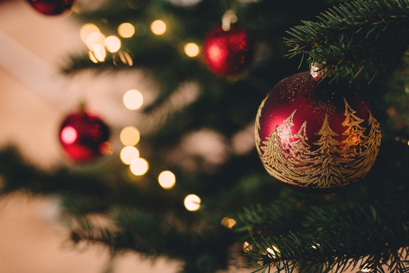 Close up with a Christmas Tree with shiny red ornaments