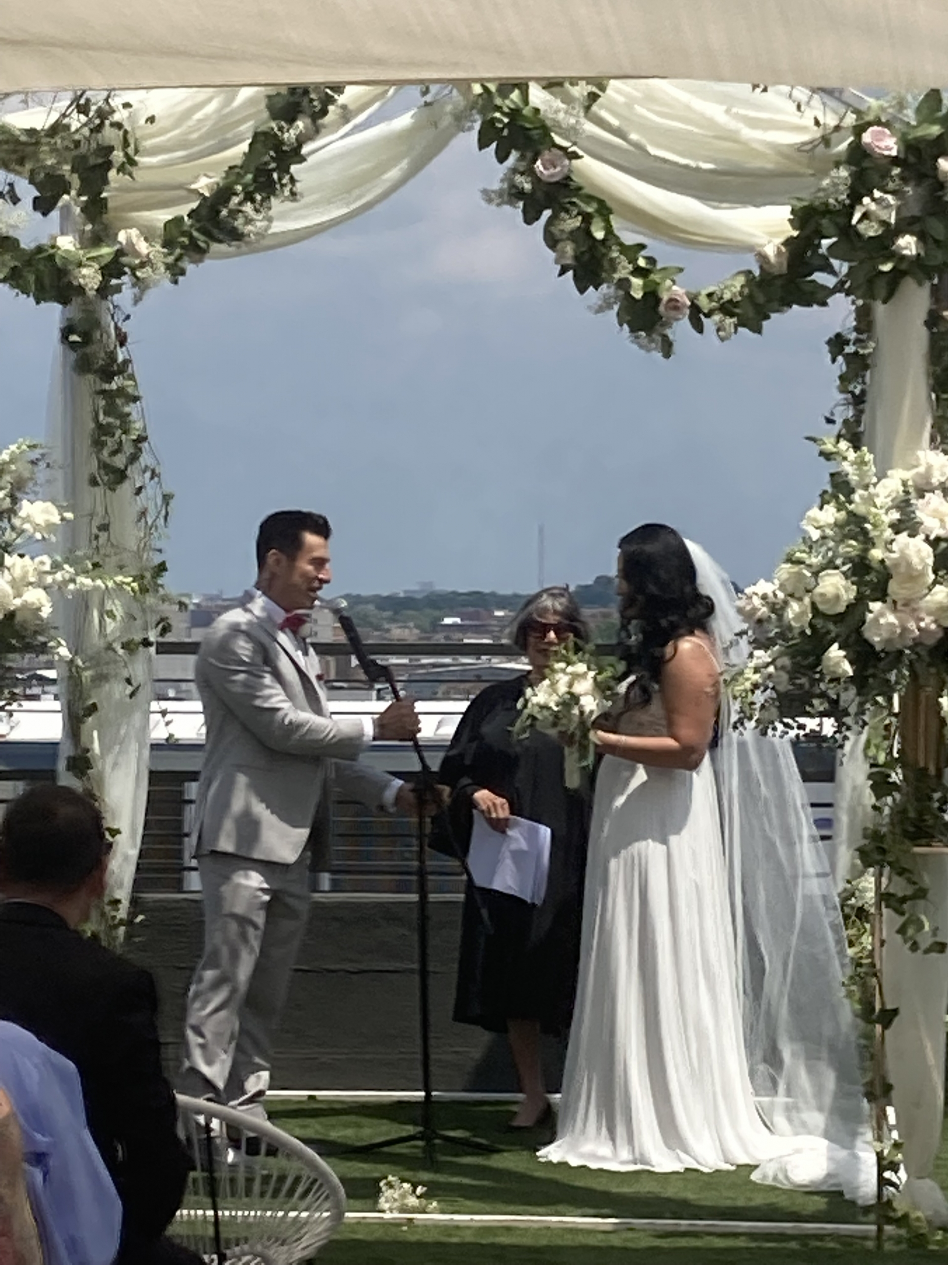 A happy couple reciting their vows outside